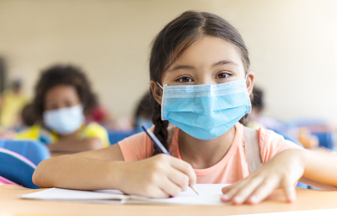 students wearing  mask and studying in the classroom