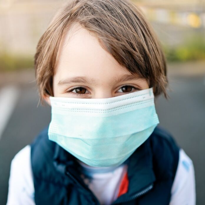 little boy wearing medical mask during coronavirus covid19 pandemic