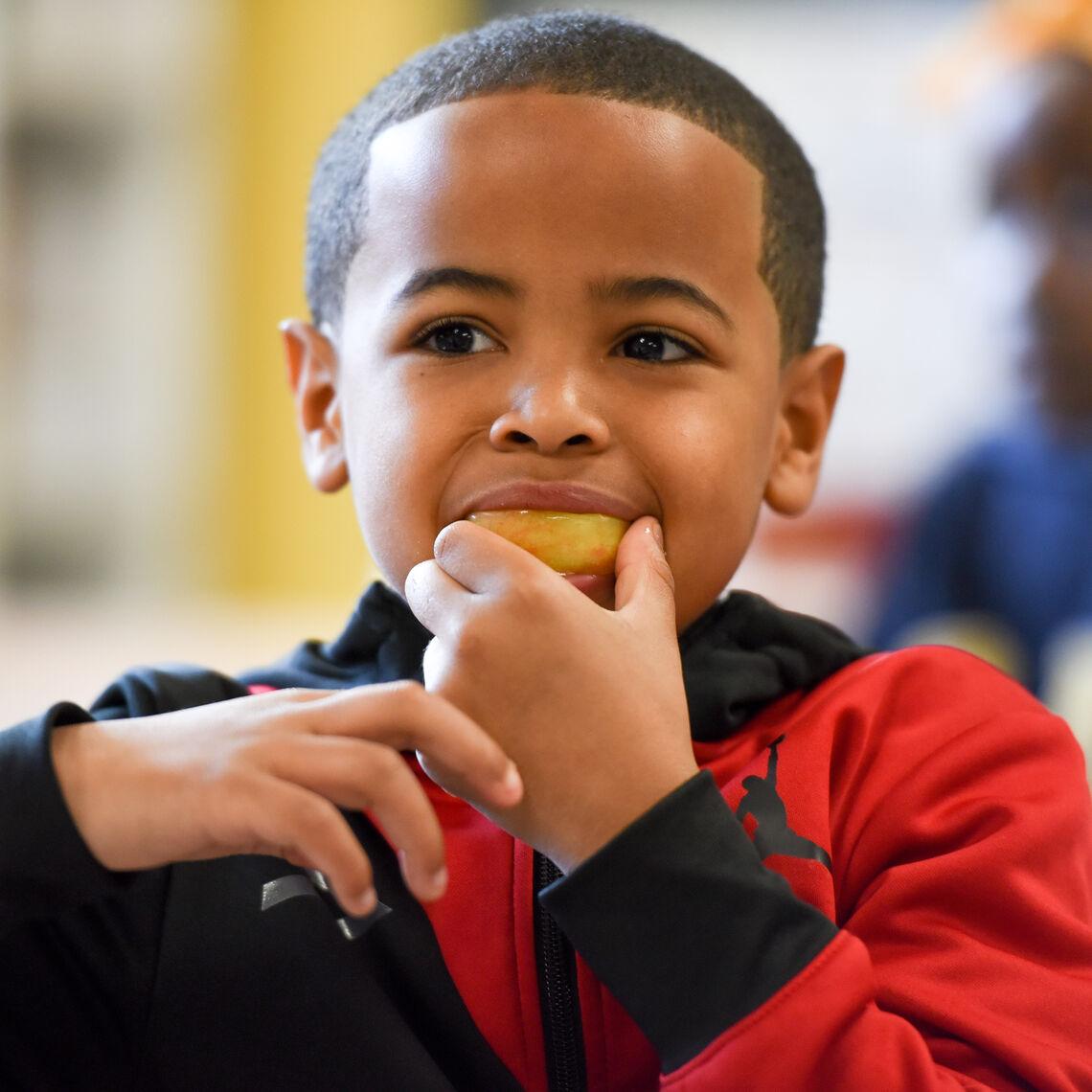 student eats breakfast in the classroom